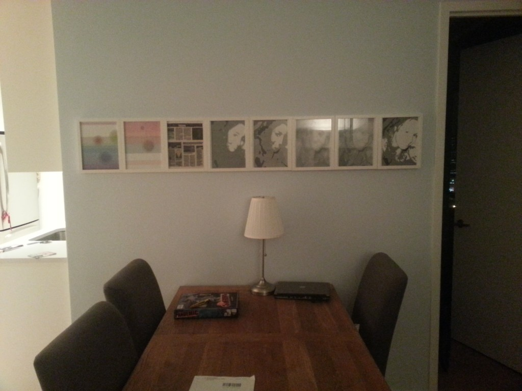 8 white frames over my dining table