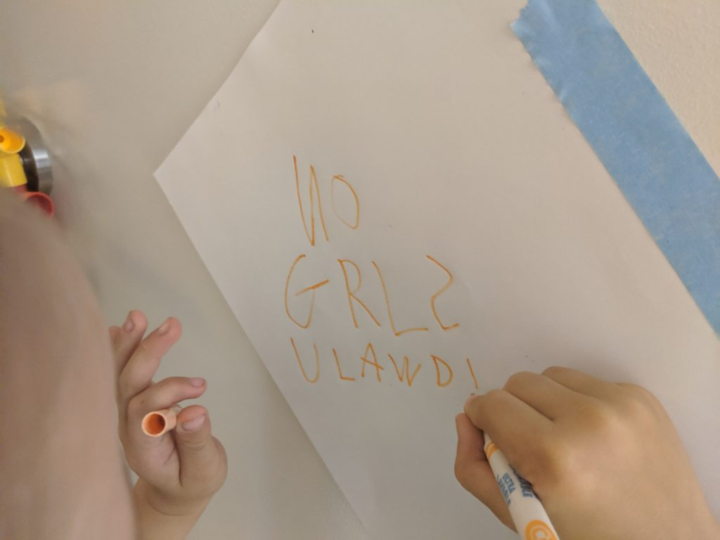 "Max scrawls out ""NO GRLS  ULAWD!"" for his door."
